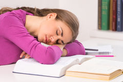 Adult student girl sitting and sleeping. Stock Image