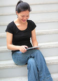 Adult student use tablet pc Stock Image