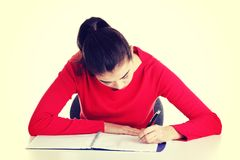 Adult student woman learnig at the desk Stock Images