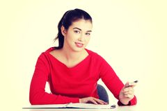 Adult student woman learnig at the desk Royalty Free Stock Photos