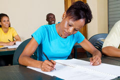 Adult students. Group of african american adult students in classroom Royalty Free Stock Image