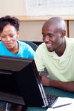 Adult students. Two adult african american students studying computer together royalty free stock photos