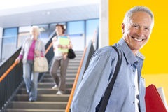 Adult students in college arriving for evening classes stock image