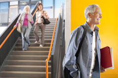 Adult students in college arriving for evening classes Stock Photos
