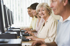 Adult students on a computer. Adult students in a computer lab Stock Photos