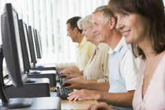 Adult students in a computer lab Stock Image