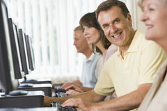 Adult students on computers. Adult students in a computer lab Stock Image