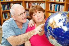 Adult Students with Globe stock photos