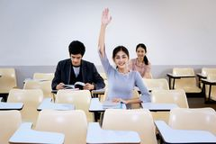 Adult students with hands up at class.  Stock Images