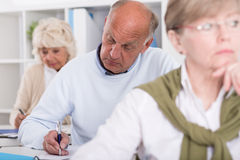 Adult students having test Stock Photo