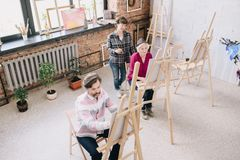 Adult Students in Modern Art Studio royalty free stock images