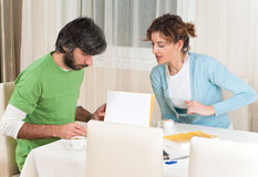 Adult Students Are Studying Together At The Desk. They are focusing to homeworks Royalty Free Stock Photography