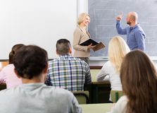 Adult students with teacher in classroom Royalty Free Stock Photos