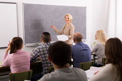 Adult students with teacher in classroom Stock Photography