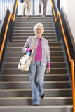 Adult students walking down stairs in college arriving for evening classes Royalty Free Stock Photos