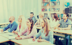 Adult students writing in classroom Royalty Free Stock Photo