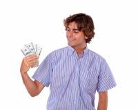 Adult stylish man smiling holding dollars. Royalty Free Stock Image
