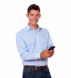 Adult stylish man texting and smiling Stock Image