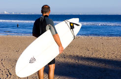 Adult Surfer. Older surfer about to enter the water in Malibu, California Stock Images
