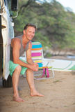 Adult Surfer at Beach. Adult male surfer sitting in van door on beach Royalty Free Stock Photography