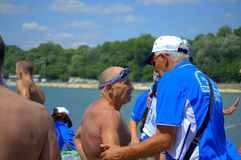 Adult swimmer interviewing after marathon finish Royalty Free Stock Photography