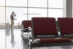 Mature bearded man waiting for flight Stock Photo