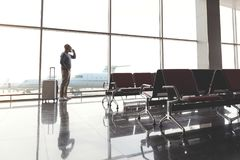 Busy man waiting for flight Stock Photo