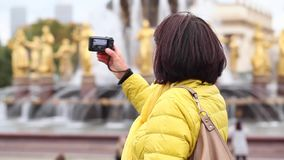 Adult tourist woman in yellow jacket stock footage