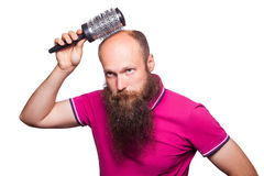 Adult unhappy man hand holding comb on bald head Stock Image