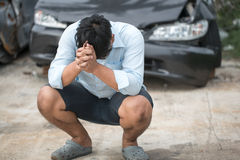 Adult upset driver man in front of automobile crash car collision Royalty Free Stock Images