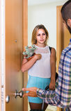 Adult watching how spouse moving out with baggage Royalty Free Stock Image