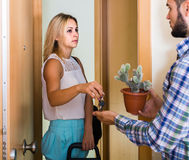 Adult watching how spouse moving out with baggage Stock Photo