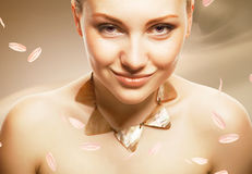 Adult woman with accessorize on sepia background. With petals Royalty Free Stock Images