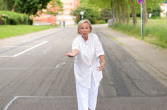 Adult Woman in All White Walking at the Street Royalty Free Stock Images