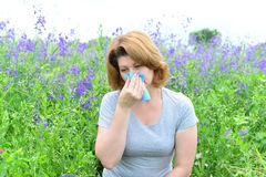 Adult woman with allergies on the Meadow Stock Photo