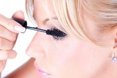 Adult woman applying cosmetic Stock Photo
