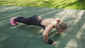 Adult woman athlete doing push-ups stock footage