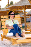 Adult woman on beach golden hour Royalty Free Stock Image
