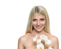 Adult woman with beautiful face and white flowers Royalty Free Stock Photos