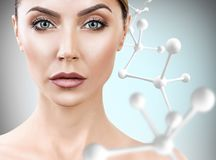 Adult woman with big white molecule chain. Royalty Free Stock Photography