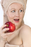 Adult woman is biting an apple. Stock Image