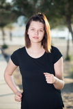 Adult woman in black T-shirt is jogging Stock Photo