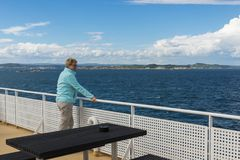 Adult woman in blue sweater on ferry Royalty Free Stock Images