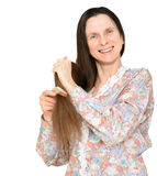 Adult Woman Brushing Hair Stock Photo