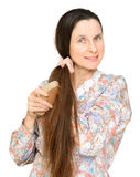 Adult Woman Brushing Hair Royalty Free Stock Photos