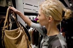 Adult woman buying ladies handbag Stock Photos