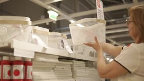 Adult woman buys household goods. stock footage