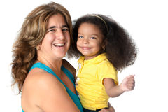 Adult woman carrying a cute african american girl Stock Photo