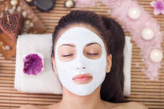 Adult  woman with closed eye having beauty treatments in the spa Royalty Free Stock Photo