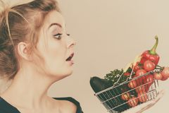 Woman with vegetables, shocked face expression Royalty Free Stock Image
